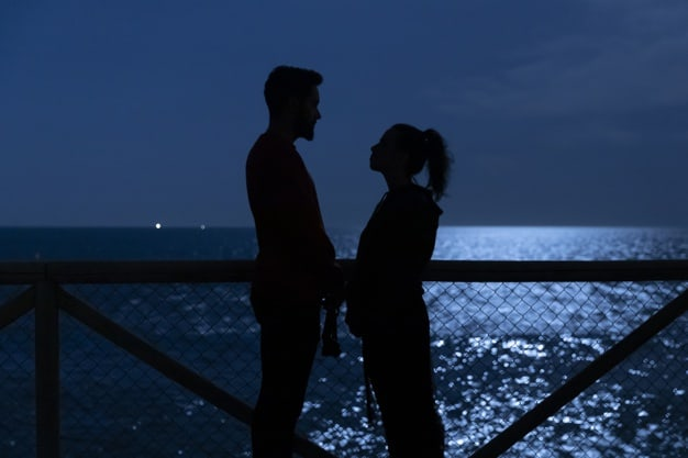silhouette of couple near the sea